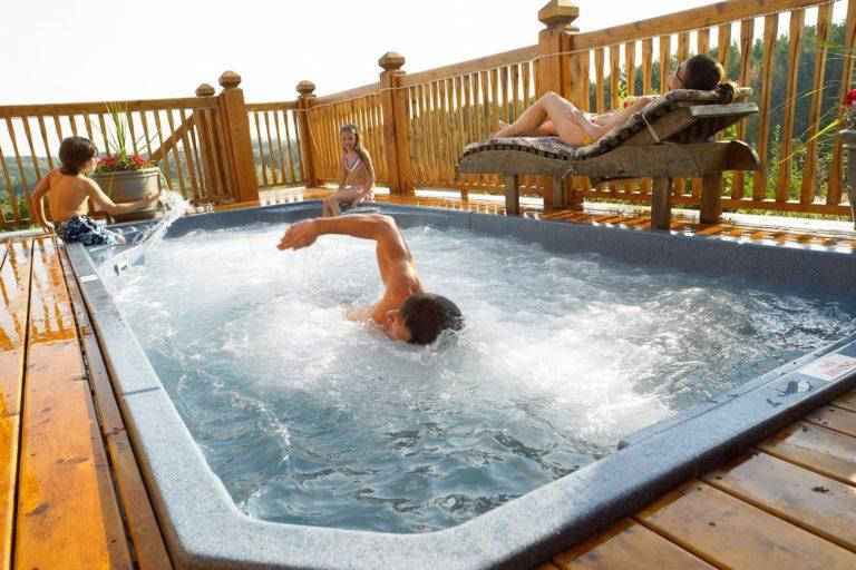 Family enjoying their Hydropool Swim Spa outside on the deck